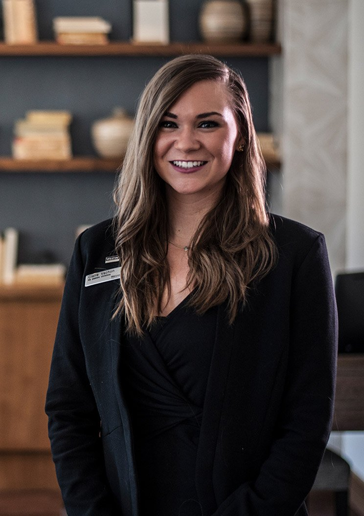 A female member of staff smiling in a White Lodging managed hotel.