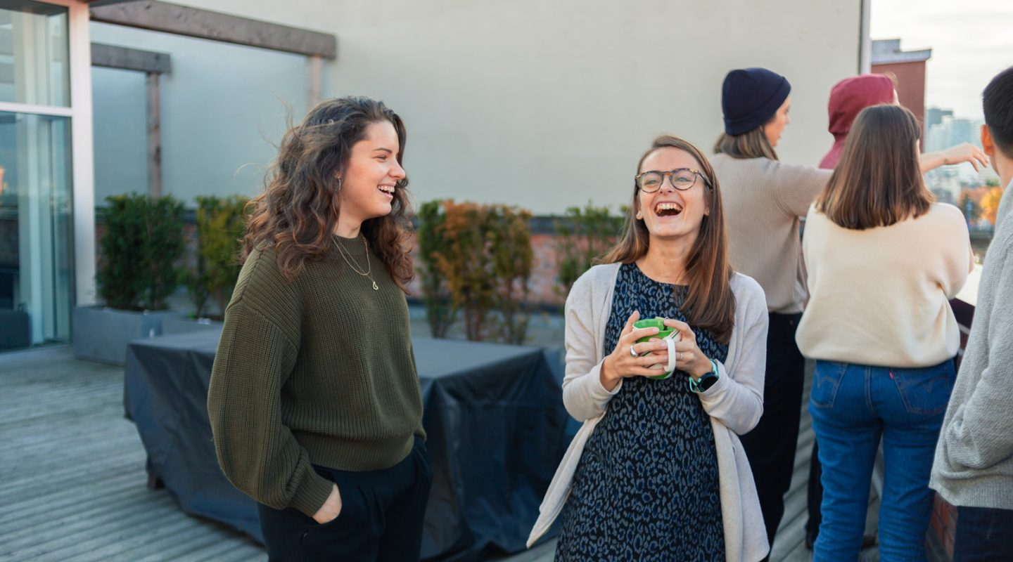 Two girls on a rooftop patio
