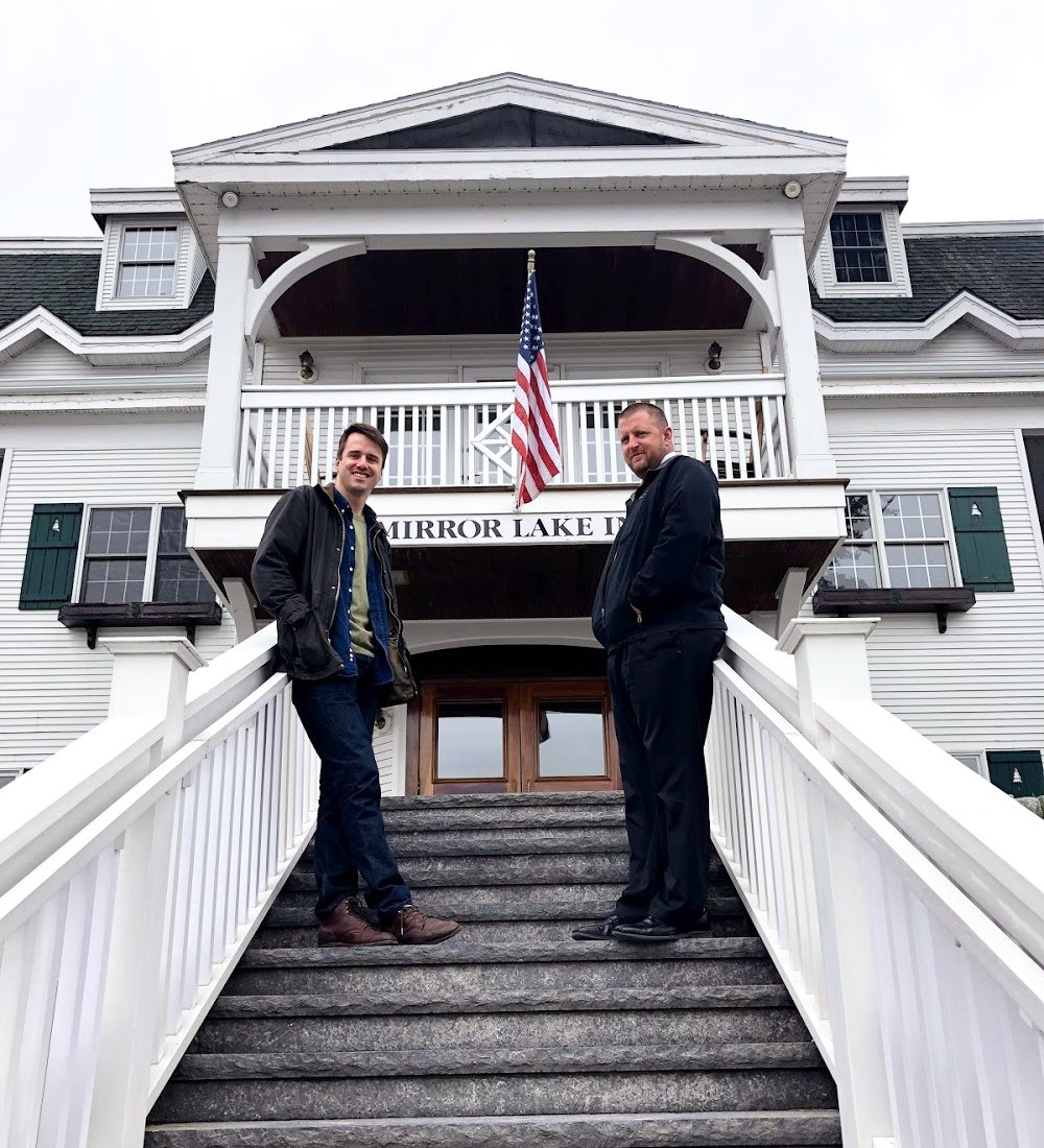 Ryan and Chris Jarvis standing on the steps of Mirror Lake Inn
