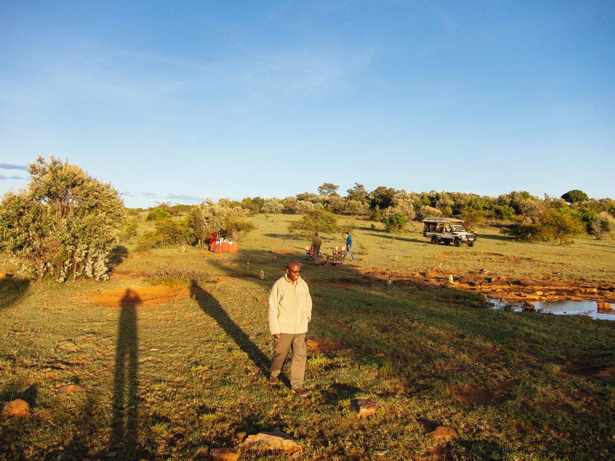 One man walking at Bushtops Camps