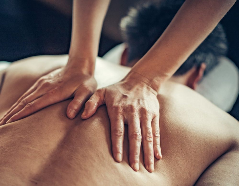 Male guest receiving a back massage