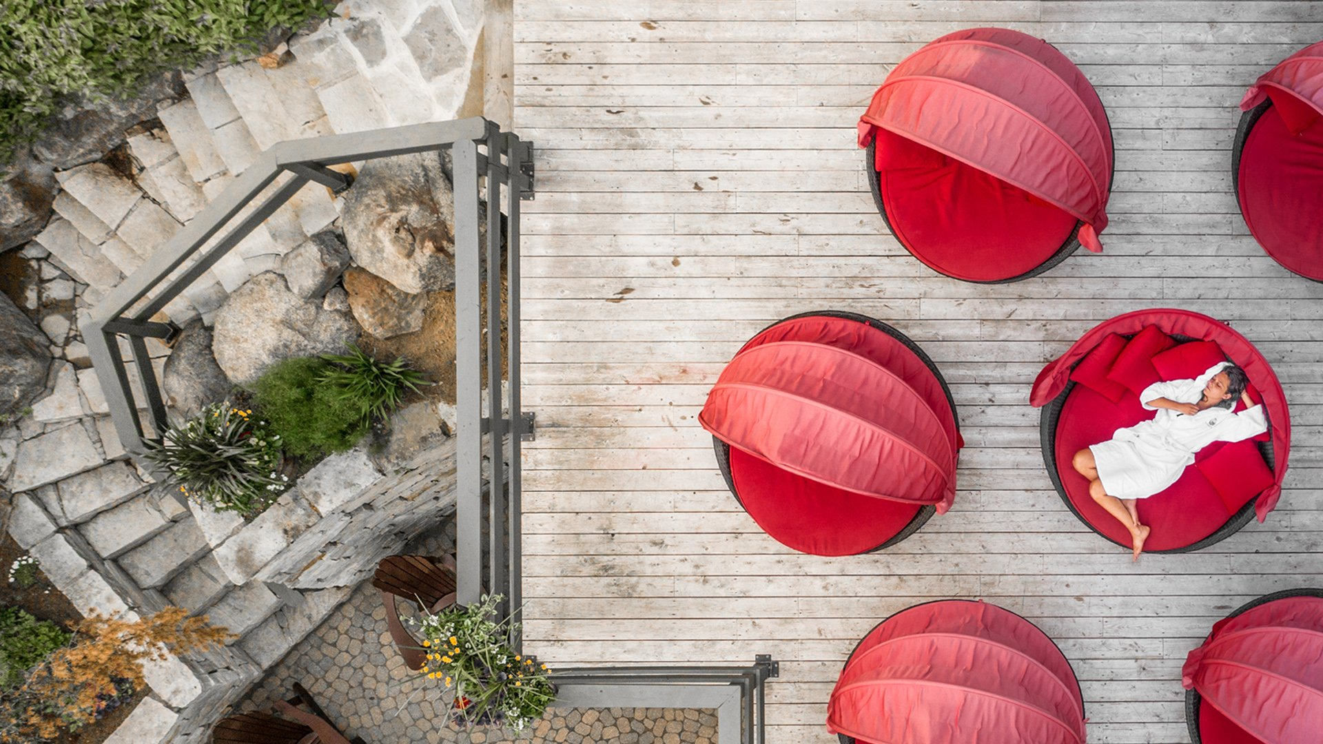 Red outdoor loungers at the Scandinave Spa